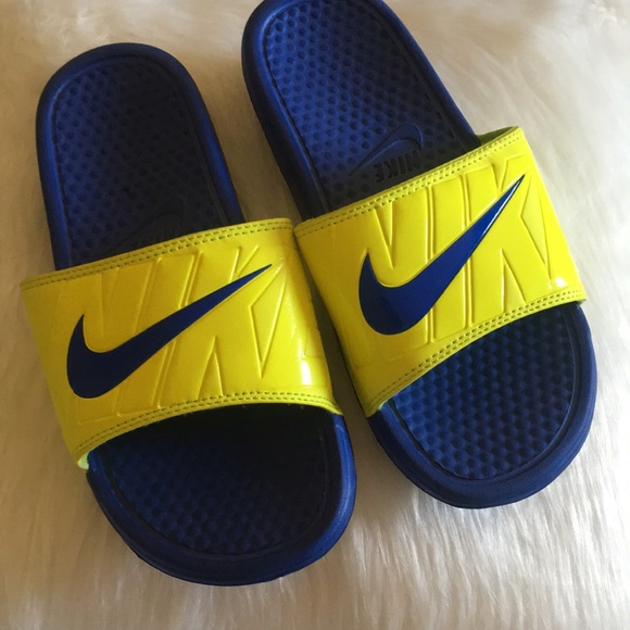 730a55b77 Nike blue   neon yellow slides men s 8.5. M 5aeb35f0a44dbe458f99ec0d